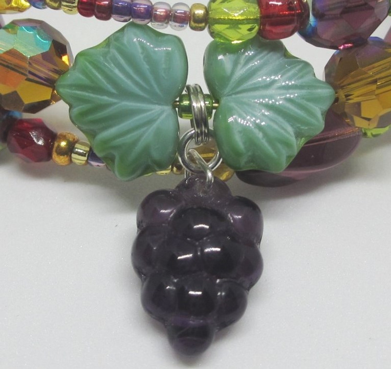 Glass grapes represent the favorite beverage of the popular plump old knight John Falstaff!
