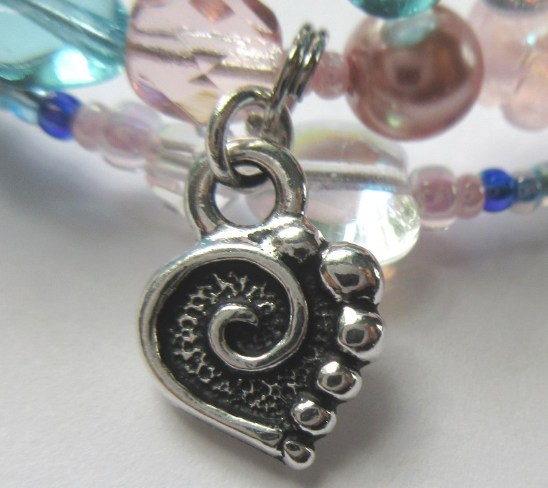 A heart charm with a tiny growing dot: Pinkerton walks from the harbor growing ever larger as he draws near.