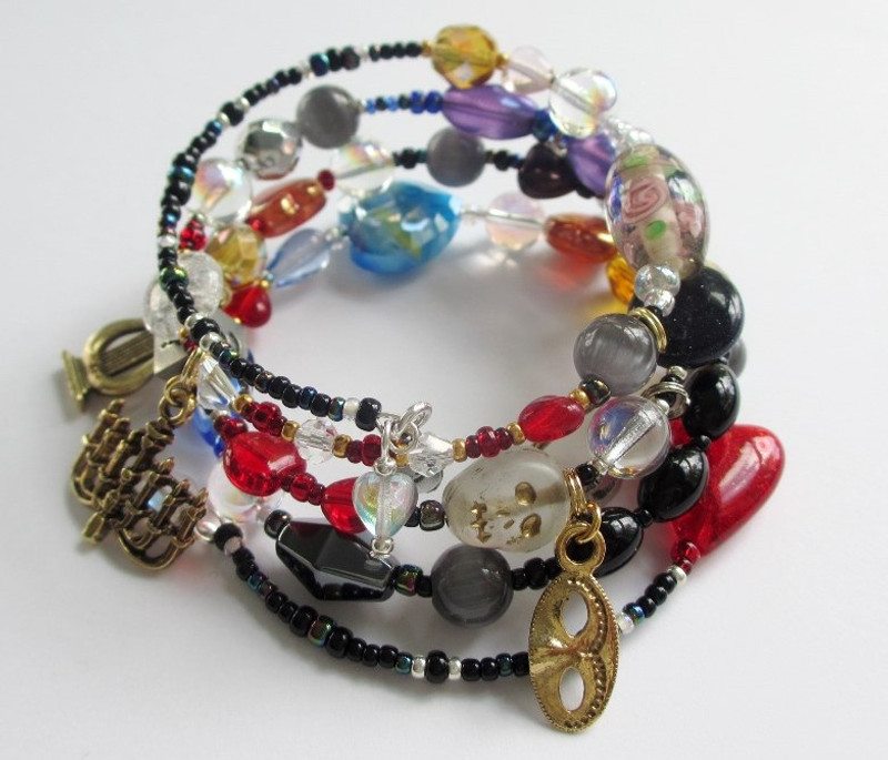 The Phantom of the Opera Bracelet, tells the famous tale with symbolic beads and charms.