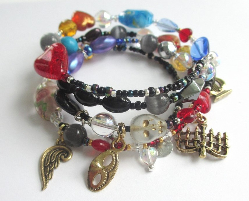 View of the bracelet featuring Erik's mask, the skull bead and angel wing (Angel of Music).