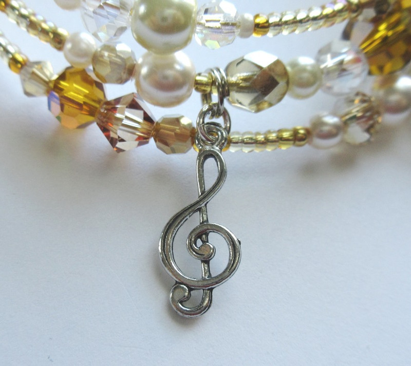 Music notes represent the Angel's power over Christine