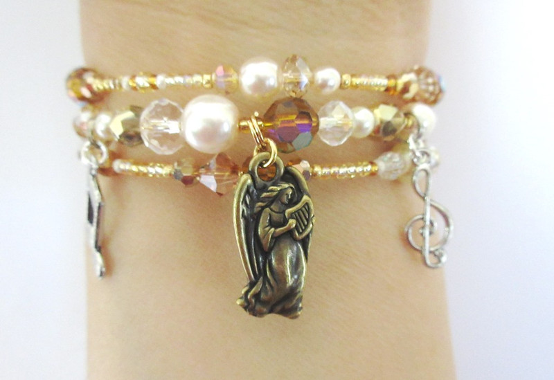 I chose gold beads and crystals with glass pearls to evoke a heavenly creature with a beautiful voice.