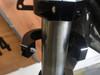 Hinged motorcycle headlight bracket