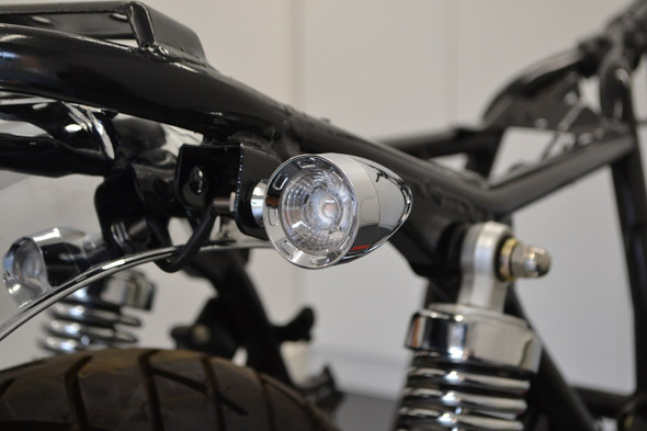 The best integrated turns signals for your bike. From stockers to big budget builds.     These Integrated LED Turn Signals are CNC machined, super bright and are very high quality. T  hey combine all the functions needed for the rear of your motorcycle packed into an all-in-one small & discreet Classic housing.  They feature a Super Bright Dual Color 3w Cree LED Chip and a projector lens which magnifies the light.  The Dual Colored LED changes color between functions - Amber LED for Turn Signals and 2 stage Red LED for your Stop & Tail Lights.   Ideal for Harley Davidson, Custom Bikes, Cafe Racers, Trikes, Streetfighters, Naked Bikes, Sport Bikes, Hot Rods, etc.  Note: LED Turn signals may require LED load resistors to control the flash speed.  SPECIFICATIONS 12 VOLT 1 X SUPER BRIGHT GENUINE DUAL COLORED 3W CREE LED CHIP PROJECTOR LENS  6061 MACHINED BILLET ALUMINIUM HOUSING  FUNCTION 1: AMBER TURN SIGNAL  FUNCTION 2: RED TAIL LIGHT FUNCTION 3: RED STOP LIGHT THREAD SIZE: M8 DEEP CHROME  UNIVERSAL FITMENT PACKAGE INCLUDES: 2 X INTEGRATED TURN SIGNALS WITH WIRING DIAGRAM