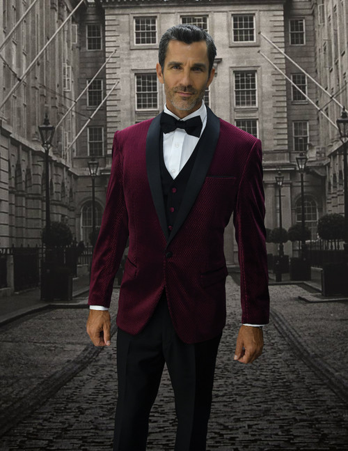 This designer style mini check Burgundy tuxedo from Statement has sharp designer look to it that will allow you to wear it out to special event and look stylish.The designer inspired modern fit jacket has black lapels, side vents of course and comes with the matching vest and no pleat plain front pants.Made of poly rayon super 150's.