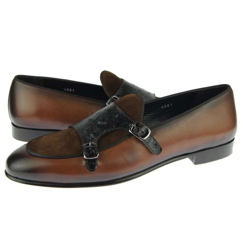 Corrente featuring a double buckle design with an ostrich skin strap. Prices are exclusive to online sales.