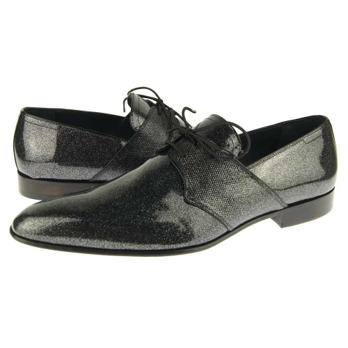 Corrente featuring a never before seen patent leather design with a touch of flake that goes an extra mile to give you that desired look. Prices are exclusive to online sales.