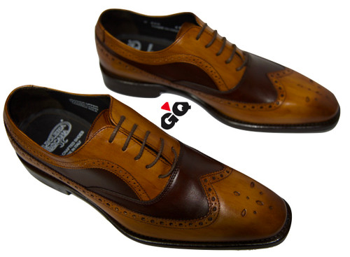 Wingtip style made in all over soft calf with perforations on toe, and trim of shoe. Burnishing on toe.