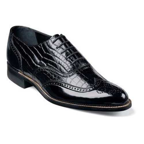 They say you can tell a lot about a man by the shoes he wears. These wing tips, complete with a crocodile print leather upper and brogue-style detailing, are perfect for a man with charm, confidence, and class.