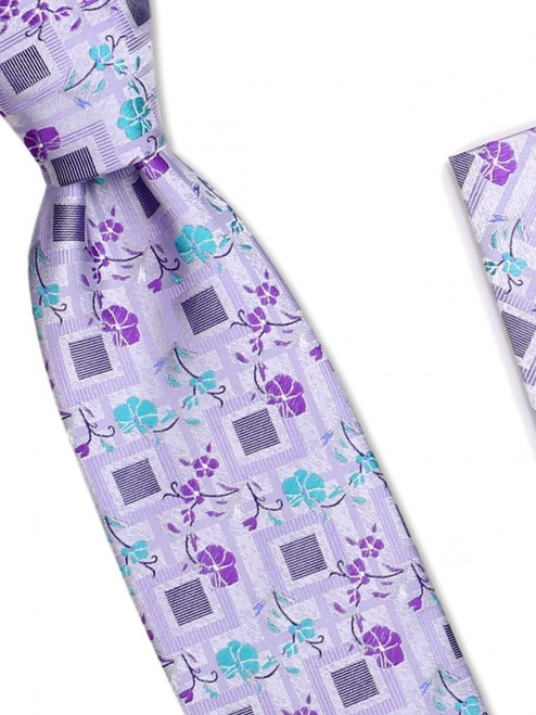 A delicate trail of flowers decorates the handsome grid of our 100% silk woven tie100% SilkIncludes Pocket Square61 inches long3 1/2 inches wid