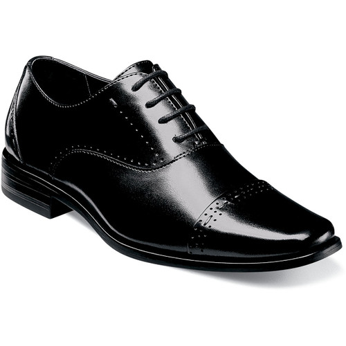 The classic design of the Barris Cap Toe Oxford makes it versatile enough for any occasion. To this Stacy Adams added style elements like a sleek silhouette and perfing and stitching details because we know you‰Ûªre never too young to look good. Durable man-made upperSynthetic liningsFully cushioned insoleNon-leather outsoleThis is a child's size shoe, not an adult style