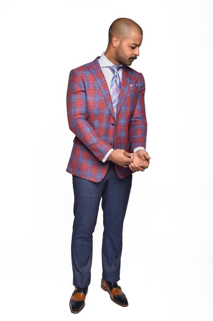 Bruno is All-American with a hint of Italian sprezz (check out the peak lapels). The festive red and royal blue ombre plaid jacket is crafted from a lighter-weight fabric and cut with more room for warm weather comfort. Lightweight denim inspired pants complete the Bruno suit.  ● Classic Fit ● 2 button single breasted jacket with peak lapel ● Double vent back ● 2 reverse pleats at shoulder blades ● Single pleat pant in lightweight indigo color fabric