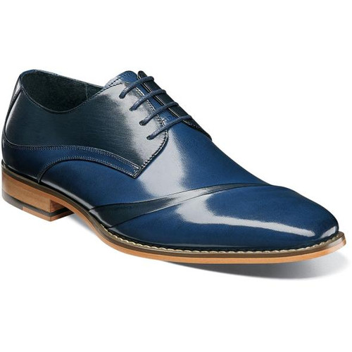 On the hunt for a shoe that will draw looks? Then give them something to look at, like the Talmadge with its high-sheen buffalo leather and double rows of stitching on the collar. As if that weren't enough, the unique, folded two-tone vamp is sure to turn heads.  Buffalo leather upper for added sheen (High sheen (gloss) buffalo leather) Fully cushioned insole with Memory Foam adds all-day comfort Leather lining for comfort and breathability Non-leather (Leather-look) dress Sole (Flexible, Durable)