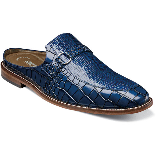 With its slip on heel, the Stacy Adams Multari Leather Sole Moc Toe Mule rides the line between sandal and loafer and offers the best of both worlds. The stylish mule features lizard print on top with croco print on the sides and a genuine leather sole. Slip into summer in style. Croco and lizard print leather upper Fully cushioned insole with Memory Foam for all-day comfort Durable leather outsole