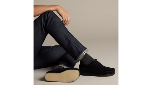 Men's Wallabees, black suede - The Wallabee has become an iconic classic in our Clarks Originals collection across the globe thanks to its moccasin construction and structural silhouette. Featuring clean and simple lines, this comfortable lace-up style uses Steads black suede with a water and stain resistant treatment. The design is finished off with our signature crepe sole which continues to stand the test of time.