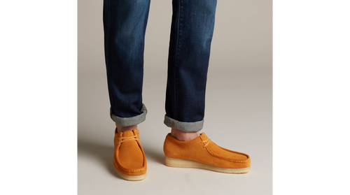 The Wallabee has become an iconic classic in our Clarks Originals collection across the globe thanks to its moccasin construction and structural silhouette. Featuring clean and simple lines, this comfortable lace-up style uses a premium tumeric coloured suede from British tannery Charles F Stead and uses a Scotchguard treatment to offer water and stain resistant properties. The design is finished off with our signature crepe sole which continues to stand the test of time.  SOLE MATERIAL Crepe  FASTENING TYPE Lace  REMOVABLE INSOLE No  TRIMS Eyelet