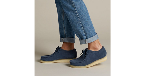 The Wallabee has become an iconic classic in our Clarks Originals collection across the globe thanks to its moccasin construction and structural silhouette. Featuring clean and simple lines, this comfortable lace-up style uses a premium deep blue coloured suede from British tannery Charles F Stead and uses a Scotchguard treatment to offer water and stain resistant properties. The design is finished off with our signature crepe sole which continues to stand the test of time.  SOLE MATERIAL Crepe  FASTENING TYPE Lace  REMOVABLE INSOLE No  TRIMS Eyelet