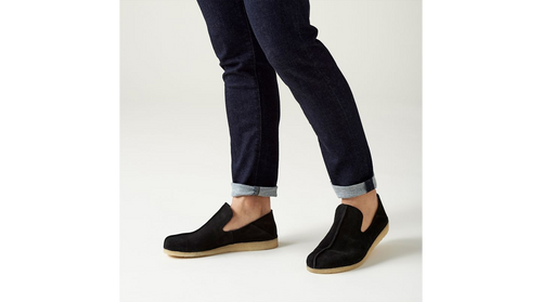 A laidback slip-on shoe with a back piece that folds down to offer another style option. With design cues from the iconic Desert Trek in the form of the central butt seam and Trek man emblem on the heel, this contemporary shoe is crafted from a black suede that is unlined to offer breathable comfort. Using a hand-stitched sachetto construction method for maximum flexibility, this style is finished off with our signature crepe sole.  UPPER MATERIAL Leather  LINING MATERIAL Leather  SOLE MATERIAL Crepe