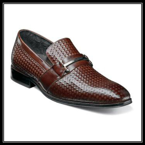 Find your stride in the Stacy Adams Fiero Plain Toe Bit Slip-On. With its diamond print leather uppers, this loafer has a one of a kind look that is hard to top. It pairs easily with dress pants and a button down for an effortless outfit. Price are exclusive to online sales.