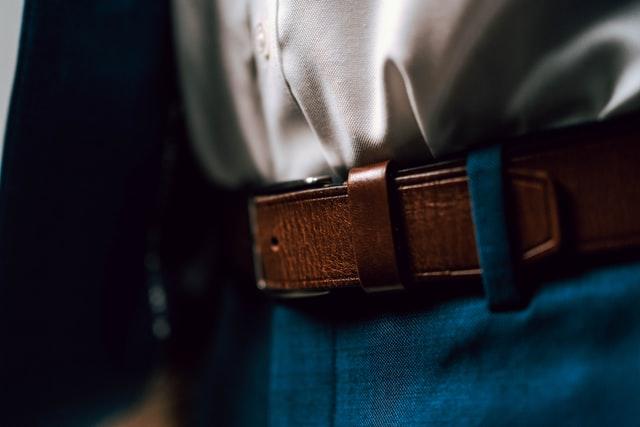 A close-up of a brown formal belt