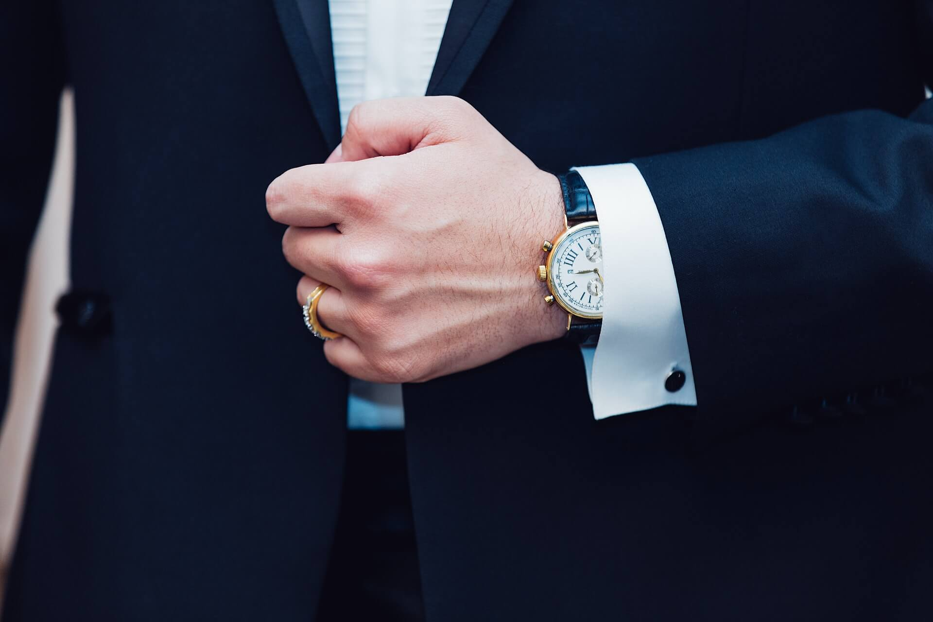 man wearing a suit with an elegant watch