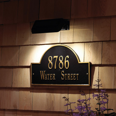 Highlight your house number or doorway easily with the Whitehall Illuminator Solar Address Lamp. This handy light offers a wire free way to keep your house number visible all evening. The back of the item has a large solar panel, which harnesses energy from the sun to charge the two included NiMH batteries. When the light's switch is in the ON position, it automatically lights at dusk and turns off at dawn. The item easily mounts to wood, siding, or masonry with the included hardware, and an adjustable hinge screw allows you to perfectly angle the light as needed. The brushed nickel colored finish will complement any surrounding, and the LED bulbs used will remain bright for several seasons. Add hassle free lighting to your wall with this Illuminator Solar Address Lamp.  - Illuminate your house numbers, address plaque, or entryway - Shines brightly up to 14 hours - Automatic: Turns on at dusk and off with dawn - Solar-Powered - Extra-long-life batteries provided - High-quality solar cells