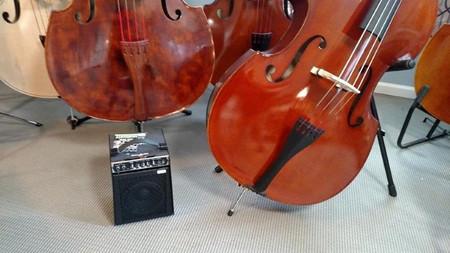 SB106 Ultra-Lightweight Combo Bass Amplifier, next to bass