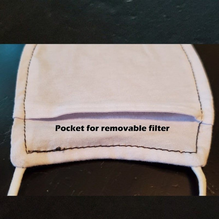 Inside of cloth face mask has a pocket for a disposable air filter