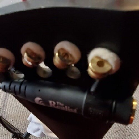 "Plastic hardware for attaching a 1/4"" inline output jack to an upright bass tailpiece - rear view, installed on tailpiece"