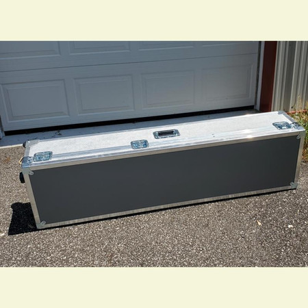 ATA hard case for Eminence Fixed Neck and Removable Neck Electric Upright Basses - laid down on ground, next to garage door to show scale