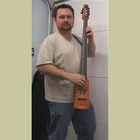 NS Design Boomerang Strap for OmniBass, EUB, and Electric Cello. Low-Profile wearable strap system. Mark demonstrating