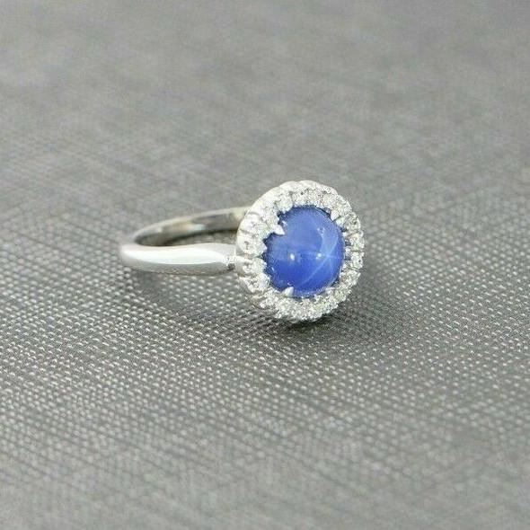 "18K WG Star Sapphire Diamond Halo Ring Maker: ""JABEL"", Circa 1950, Size 4"