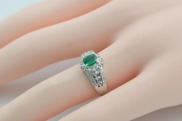 Platinum Oval Emerald and Diamond Halo Ring Size 7.25