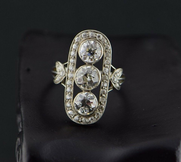 Circa 1910 Superb Platinum Edwardian Diamond 3 Stone Halo Ring, Size 5
