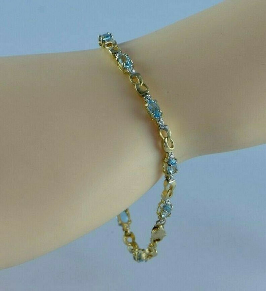 "10K YG 3ct tw Blue Topaz and Diamond Illusion Bracelet 7"" length Circa 1980"