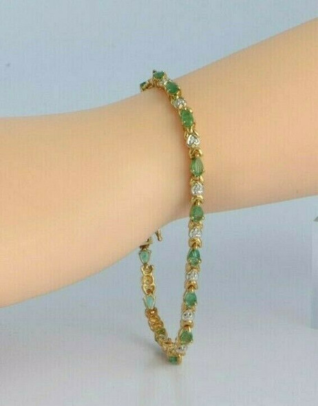 "10K YG 4 ct tw Emerald and Diamond Accent Bracelet 7.25"" length Circa 1970"