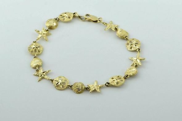 """14K Yellow Gold Marine Life Charm Bracelet Signed DZ 7.5"""" length"""