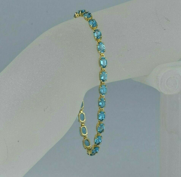 "14K Yellow Gold 10 ct Blue Topaz Bracelet 23 Stones 7"" length, Circa 1990"