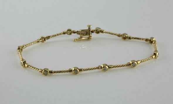 14K YG Diamond Cable Bracelet 12 Collet Set Stones 7.25 Inches Circa 1990