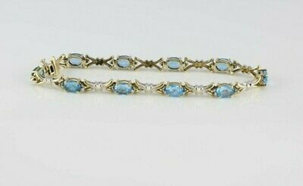 10K YG 7ct tw Blue Topaz and Diamond Accent Bracelet 7.75 Inches
