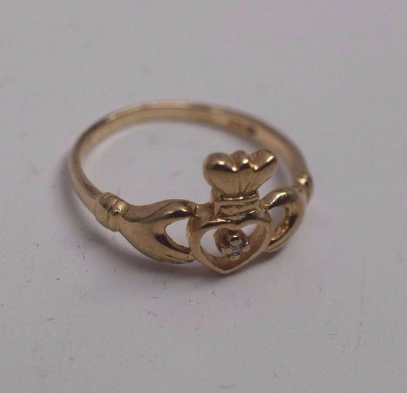 10K Yellow Gold Claddagh Ring with a Diamond Chip, Size 6.75