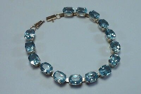 10K Yellow Gold and Blue Topaz app 30 ct. tw. 7 inch Bracelet