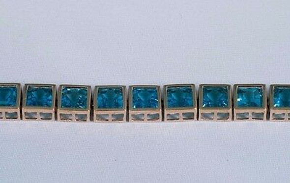 "10K Yellow Gold Blue Topaz app. 25 ct. tw. Square Stone Bracelet, 7"" Long"