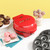 BabyCakes 3-in-1 multi plate treat maker red MT-6 lifestyle image with plated cupcakes, donuts and cake pops Select Brands