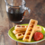 Babycakes Mini Waffle Sticks on plate with syrup WMM-40 Select Brands