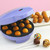 Babycakes cake pop maker lifestyle image with decorated cake pops on sticks CP-12 Select Brands