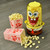 SpongeBob Stir Popcorn Popper lifestyle image with popcorn NKL-60 Select Brands