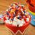 Wonder Woman Stir Popcorn Popper lifestyle photo colorful popcorn DCW-60CN Select Brands