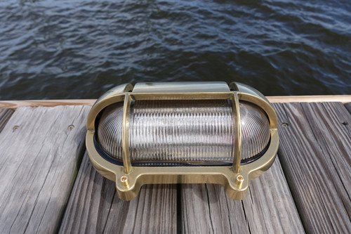 brass oval nautical light with eyebrow