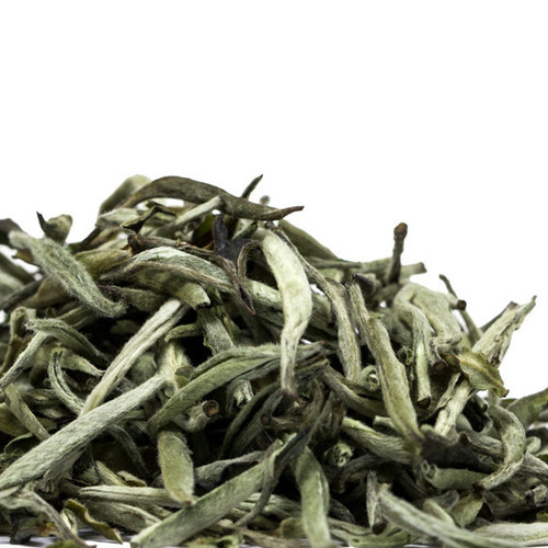 Silver Needles, Yin Zhen,  is a white tea produced in the Fujian Province in China. This first flush harvest was plucked in late March and early April producing young buds that are light green in color and covered with downy hair that creates a velvet like appearance. It steeps a sweet, some may detect subtle notes of peach, apricot and honey, delicate cup with a savory mouth feel. There is simply nothing that compares to quality Silver Needles from the Fujian Province. Steep: 1-1.5 tsp, 185 degrees for 2 Minutes
